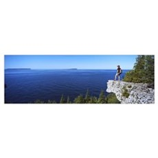 Hiker on a cliff Georgian Bay Bruce Peninsula Nati Poster