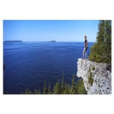 Hiker on a cliff Georgian Bay Bruce Peninsula Nati
