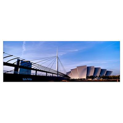 Footbridge with an auditorium at dusk Bells Bridge Poster