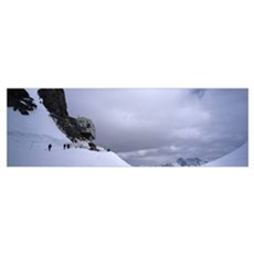 Hikers on a snow covered mountain Monchjoch Hut Mt Poster
