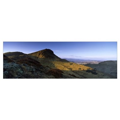 Sunlight over a mountain peak Arthurs Seat Edinbur Poster