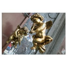 Close-up of two golden cherubs, Naples, Campania, Poster