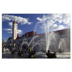 Fountains in front of a railroad station, Milles F Poster