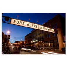 Signboard over a road at dusk, Fort Worth Stockyar Poster
