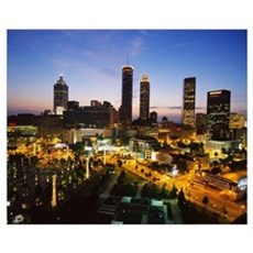 High angle view of buildings lit up at sunset, Cen Framed Print