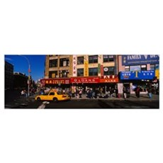 Yellow taxi on the road, Chinatown, Manhattan, New Framed Print