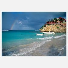 Rainbow over Caribbean Sea, boats docked cliffside
