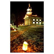 Luminaries outside small church at night, winter,  Poster