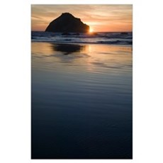 Sunset behind silhouetted sea stack on Bandon Beac Poster