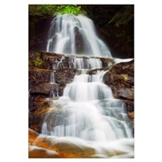 Low angle view of water cascading over rocky cliff Canvas Art