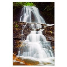 Low angle view of water cascading over rocky cliff Poster