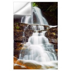 Low angle view of water cascading over rocky cliff Wall Decal