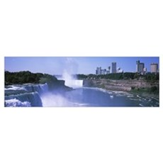 Waterfall with city skyline in the background, Nia Poster