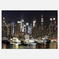 Buildings in a city lit up at night, Hudson River,