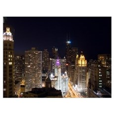 Buildings in a city lit up at night, Magnificent M Canvas Art
