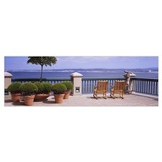 Chairs and potted plants on a deck, Monterey Bay, Poster