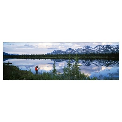 Mountain scene with lake reflection, fisherman at Poster