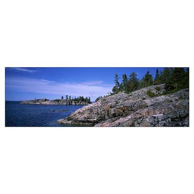 Rock formations at the lakeside, North Shore, Lake Poster