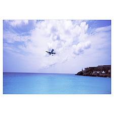 Airplane flying over the sea, Princess Juliana Int