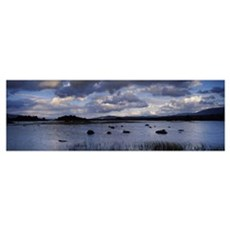 River with a mountain range in the background Loch Poster