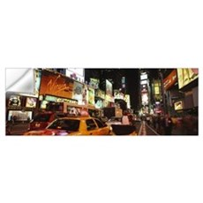 Buildings lit up at night in a city Broadway Times Wall Decal