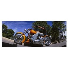Low angle view of a man riding a motorcycle, Wisco Framed Print