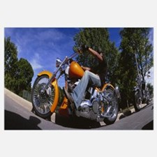 Low angle view of a man riding a motorcycle, Wisco