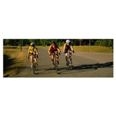 Three mid adult women cycling Framed Print