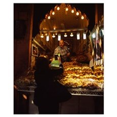 Rear view of a woman buying pastries at a market s Poster