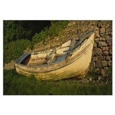Old fishing boat in front of a stone wall, Westpor