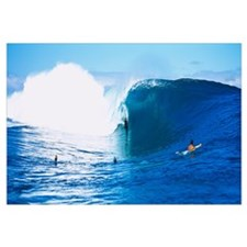 Three people bodyboarding in the ocean, Tahiti, Fr