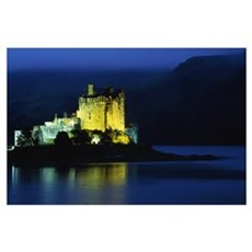 Eilean Donan Castle illuminated at night, water re Poster