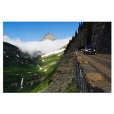 Cars on Going to the Sun Road through mountainside Poster