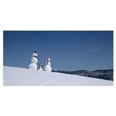 Snowmen in snow covered landscape, Waterbury, Verm Poster