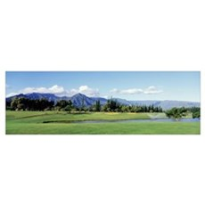 Golf course in front of mountains, Princeville, Ka Poster