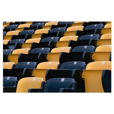 Empty row of seats in sports stadium Poster