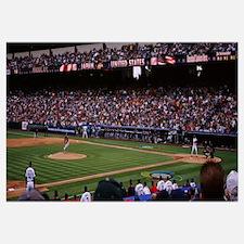 Spectators watching baseball game in a baseball st