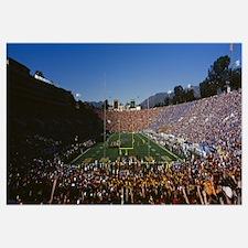 Spectators watching a football match in a stadium,