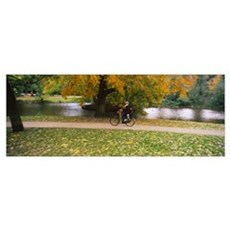 People riding a bicycle in the park, Vondelpark, A Poster