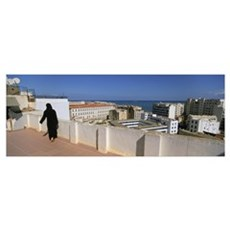 Rear view of a woman walking on the roof, Algiers, Poster