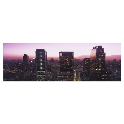 Buildings lit up at dusk, Santiago, Chile Framed Print
