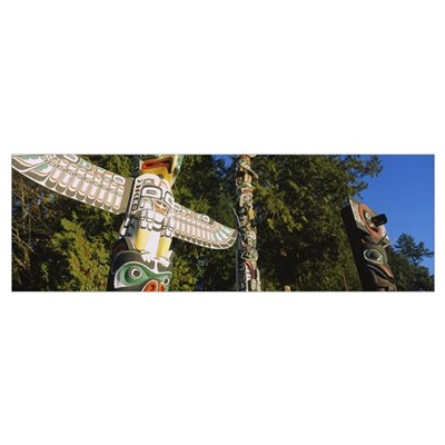 Low angle view of three totem poles, Stanley Park, Poster