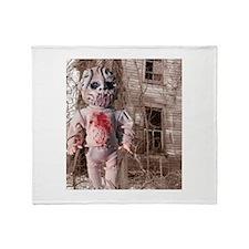 Scary Nigel doll Throw Blanket