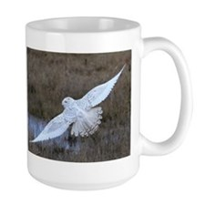Snowy Owl in flight Mug