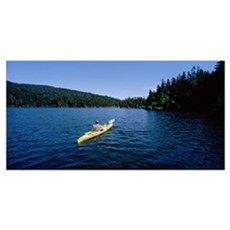 Rear view of a man on a kayak in a lake, Orcas Isl Poster