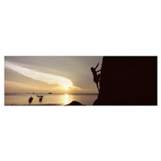 Silhouette of a person rock climbing Poster