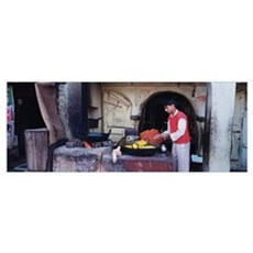 Side profile of a young man preparing sweet food,  Framed Print