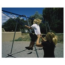 Rear view of a mother pushing her son on a swing,  Poster