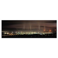 High angle view of oil refinery at lit up at night Poster