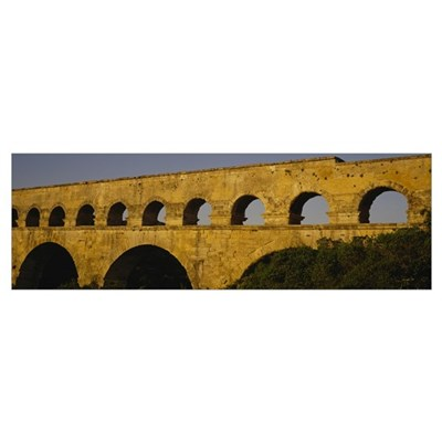 High section view of an ancient aqueduct, Pont Du Poster